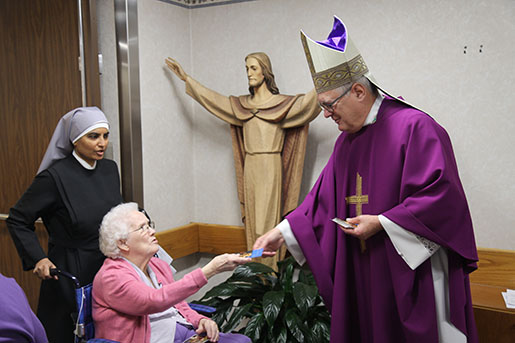 Bishop tobins annual advent visit to jeanne jugan residence the bishop then visited the residents in the dining rooms he went from table to table and spent time greeting and talking to each resident m4hsunfo